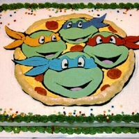 Ninja Turtles Cake Fondant cutouts, pizza is buttercream.