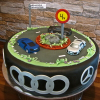 Car Cake I made this birthday cake for a 4-year old car enthusiast, Oliver. I was told he recognises all the different car types and is especially...