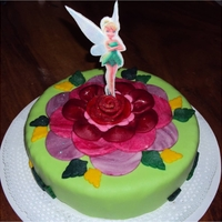 Tinkerbell Basic cake covered with fondant made figures...the tinkerbell is made of rice paper, you can eat it all!