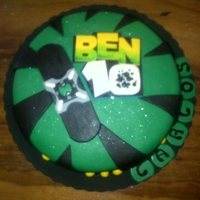 Ben 10 Cake Basic cake filled with milk caramel, painted in green with sugar cover. All designed in sugar.
