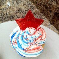 4Th Of July Cupcake   Red with a blue funfetti cake topped with non dairy whip and a jolly rancher star!