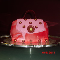 Red Fondant Purse Cake Red purse cake covered with fondant and filled with marshmallow butter cream. Made it for a combination Mother's day/ Birthday cake...
