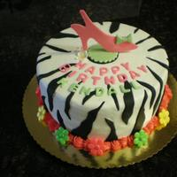 Zebra Print Birthday Cake Zebra print on this 4 year old's birthday cake with fondant accents.