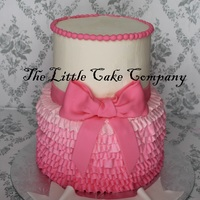 Ombre Ruffles cake iced in buttercream with buttercream ombre ruffles. The couple were going to put their own tiara on top