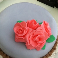 Fondant Rose Cake This was my fifth attempt with fondant. My husband wanted to see flowers on this cake that I was making for my friends' birthdays. So...