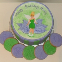 Tinkerbell Cake My niece requested a Tink cake but she had to be wearing roller boots, I have no idea why? :)I handpainted tink with gel colours.She also...