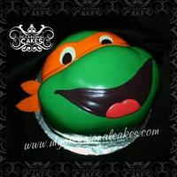"Tmnt - Michaelangelo sculpted from two 9"" round cakes and covered in MMF."