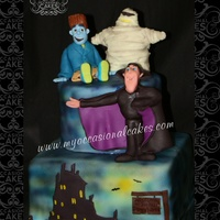 "Hotel Transylvania(Tm) Inspired Cake  Inspired by the recent film ""Hotel Transylvania""TM, this cake features 3 sculpted fondant figures and a 2-d fondant..."