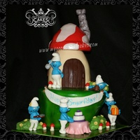 "Smurfs Cake For Icing Smiles Smurfs themed 3-D cake for an Icing Smiles recipient. Bottom tier carved from 10"" rounds (3-layers). House carved from 6&..."