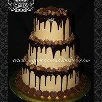 "Chocolate-Peanut Butter Cup Cake  Chocolate layer cakes (10-8-6"") filled and iced with peanut butter BC frosting, drizzled with chocolate ganache and topped with mini..."
