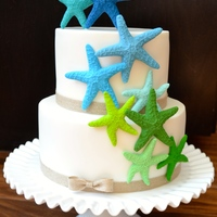 Bright And Cheerful Star Fish Cake To Celebrate A Birthday Star Fish Were Made From Coloured Fondant Bright and cheerful star fish cake to celebrate a birthday. Star fish were made from coloured fondant.