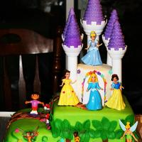 Dora's Royally Enchanted Adventure I fondly called this my multiple personality disorder cake! *LOL* My friend's daughter wanted a Dora, TInkerbell/Disney Fairies and...