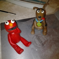 Scooby And Elmo   Elmo gum paste figurine and a scooby doo gum paste figurine.