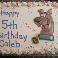 Caleb Scooby-Doo in fondant. Writing matched Caleb's (well, pretty close...)