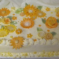 Yellow Food Potluck Day Mandarin orange cake filled with creamsicle custard and iced with pineapple-vanilla whipped cream. Flowers and leaves are fondant....