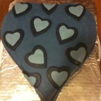 Blue Heart German chocolate almond cake, chocolate almond cream cheese icing, and buttercream fondant.