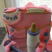 Diaper Bag chocolate cake with cream cheese buttercream. Baby bottle is made of cake also. gumpaste pieces consist of the binky, bottle nipple, baby...