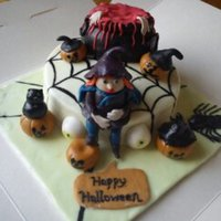 My First Halloween Cake  This is my first halloween cake. I,m really pleased how it turned out. My girls and i took it to the halloween disco to rafle. Really...