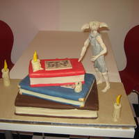 Harry Potter Books With Dobby individual book cakes with dobby figure , dobby made from modelling paste, cake was for halloween display