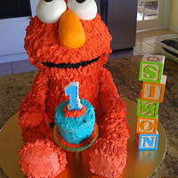 1St Birthday Cake For my son. My first 3D cake. The picture was just taken off my phone so its not the best. I placed the eyes on looking up and then I...