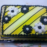 Black Yellow And White Daisies I love black, yellow, and white together and this was a cake I did for the cake case at work. I often fill the cake case up with my '...