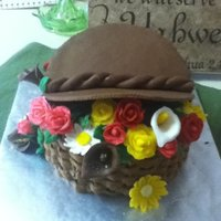 Flower Basket Cake Carrot cake with spiced butercream icing. Flowers and lid are made of modeling chocolate.