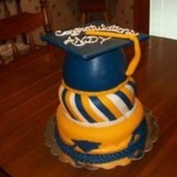 First Graduation Cake The bottom cake was a dummy just for presentation. The top of the cap was just cardboard covered with fondant. The Grad caps on the side of...