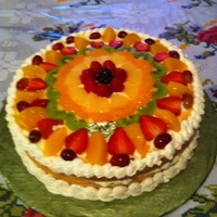 Fruit Cake W Cream Cheese Fillinh Yellow cake with cream cheese and fruit on top