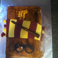 Harry Potter Book Harry Potter Book Cake for a 13 year old girl. Vanilla cake with cookies and cream filling. Covered in buttercream and MMF. Wand and...