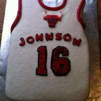 Chicago Bulls Jersey  Chicago Bulls Jersey cake made for a 16-year-old boy whose last name is Johnson. The bull emblem is free hand cut from gum paste and hand...
