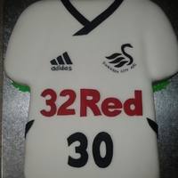 Swansea City Football Club Cake lemon sponge with buttercream and rasp jam covered in sugarpaste