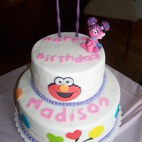 Elmo Abby Cake   This was my first attempt at fondant. My grandaughters 2nd birthday.