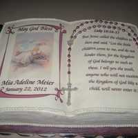 Baptism Cake WASC Cake with Raspberry Filling, vanilla buttercream icing, decorated with rosary and book cover.