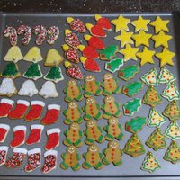 Mini Christmas Cookies Mini Christmas cutouts decorated with buttercream and various sugars, sprinkles, etc.