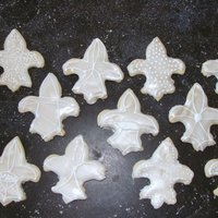 Fleur De Lis Cookies These cookies are just something I was testing out. They're covered in quick pour fondant with royal icing accents, dusted with luster...