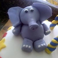 Fondant/gumpaste Elephant  This is my first attempt at a gumpaste figure. Inspired by a few figures I saw on here and elsewhere online, I came up with this little guy...