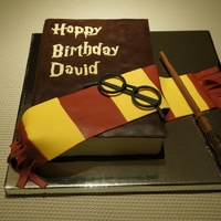 Book Cake For A Harry Potter's Fan My first attempt at a closed book cake!Homemade chocolate fondant for the cover (a nightmare to work with, by the way!)Letters, magic wand...