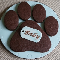 "Chocolate Paw Print This a big chocolate sandwich cookie (filled with homemade ""dulce de leche"") that I made for a paw print themed baby shower."