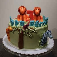 "Safari Cake For Twin Girls The animals are made from a mix of fondant and gum paste. The letters of ""Happy Birthday"" are molded candy melts. The cake is..."