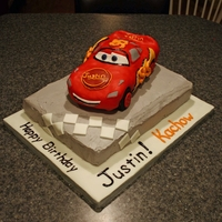 Lightning Mcqueen Lightning mcqueen cake for a 4th birthday. Car is made of cereal treats and the road is a confetti cake covered and filled with swiss...