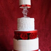 Rose Wedding Cake Top two tiers are cake dummies covered in royal icing. Bottom tier is Chocolate cake filled with chocolate pudding covered in vanilla...