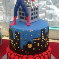 Spiderman Birthday Cake Used fondant to cover and designs on the cake. Web was made with royal icing.