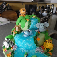Jungle Theme animals were made out of fondant mixed with a little of gum-tex. For the waterfall, i used white buttercream and covered it with sky blue...
