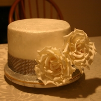 Baptism Cake Inedible bling unfortunately. Fantasy roses made from gumpaste.