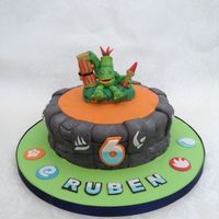 Skylanders Birthday Cake Skylanders birthday cake. All decorated in fondant & gumpaste. The effect on the rocks was made using scrunched up tinfoil and dark...