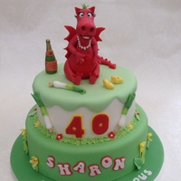 Welsh Themed Dragon Cake Welsh dragon decorated as instructed by Sharon's husband with pearl necklace, earrings, eyelashes and red lipstick! I decorated the...
