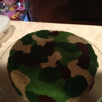 Camo Birthday Cake chocolate cake filled with chocolate fudge. This was a new method I had looked up and did just for fun. Deffinitely needs improvement, but...