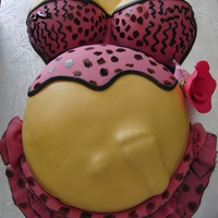 Pregnant Belly Cake Vanilla cake, moist with Pinnacle cake Vodka and filled with Raspberry and Pineapple