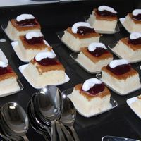 "Mini Cakes Traditional Spanish 3 Milks cake, just added an additional milk ""coconut milk"" topped with Raspberry and Swiss merengue"
