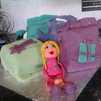 Shopping Frenzy first proper attempt at decorating a cake. Madeira cake covered in buttercream and fondant icing. From Debbie Brown's 50 easy party...